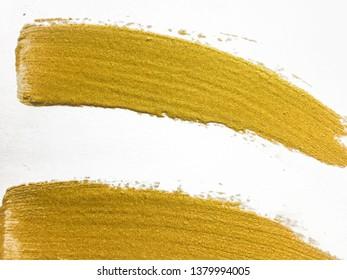 gold paint brush strokes  on white background