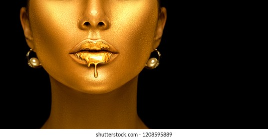 Gold Paint drips from the lips, lipgloss dripping from sexy lips, golden liquid drops on beautiful model girl's mouth, gold metallic skin make-up. Beauty woman face makeup close up, isolated on black