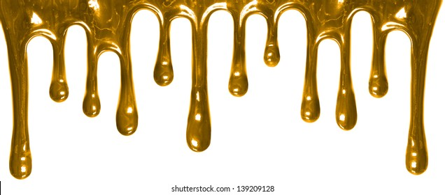 Gold paint leaking isolated on white background. streams