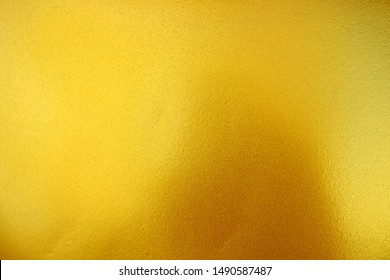Gold Paint on Concrete Wall Texture Background. (Selective Focus)
