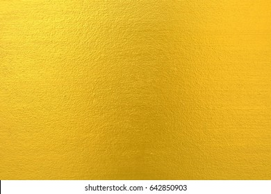 Gold Paint on Concrete Wall Texture Background.