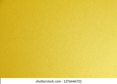 gold painted texture abstract for background, shiny yellow gold pattern background