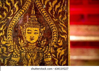 gold painting on wood doors