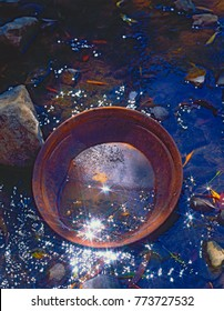 Gold panning Australia, many creeks in Australia still produce amounts of alluvial gold ,the Summer hill creek near Orange in N.S.W.is one of them.
