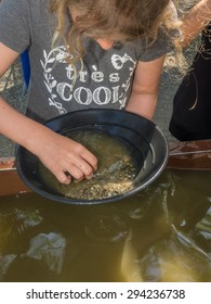 Gold panning is a form of placer mining and traditional mining that extracts gold from a placer deposit using a pan.