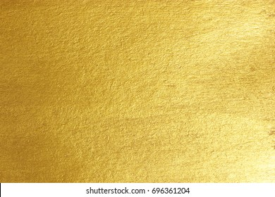 Gold paper background Golden paper surface as background