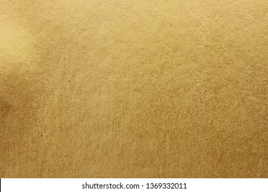 Gold paper texture background. gold wall background