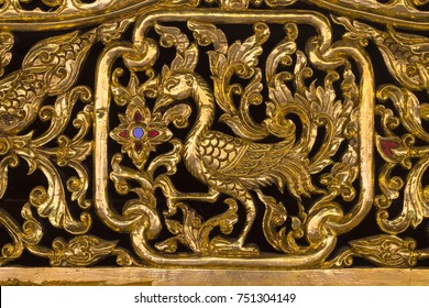 gold peacock wood carving thai style, decorate in thailand temple.