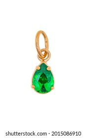 A gold pendant with a green emerald. The jewelry is isolated on a white background