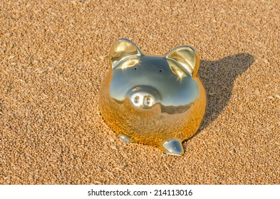 A gold piggy bank in a pile of wheat