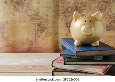 Gold Piggy bank stand on top of book
