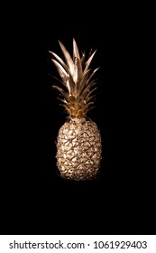 Gold pineapple on black background
