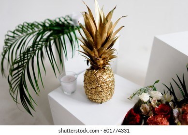 Gold pineapple with wedding decor