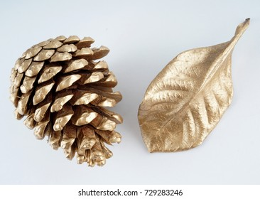 gold pinecone and gold leaf. Christmas decoration. isolated on white background