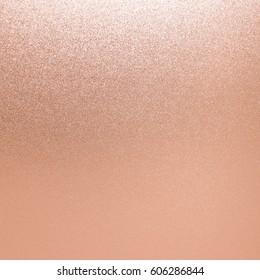 Gold pink background rose foil texture. Glitter sparkle metal shimmer.