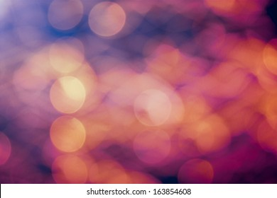 Gold, pink and blue blurred lights in the night