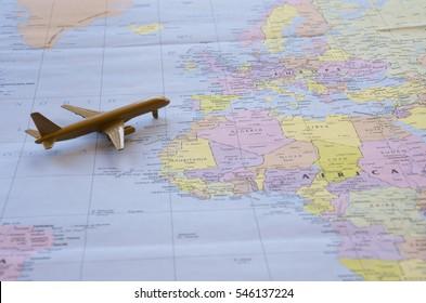Gold plane over Atlas