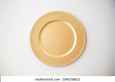 Gold plate on white background.