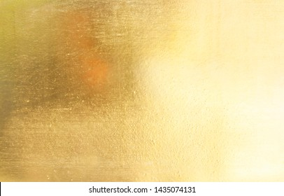 Gold plate with scratches on the background surface
