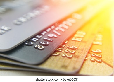 Gold and platinum credit cards close up
