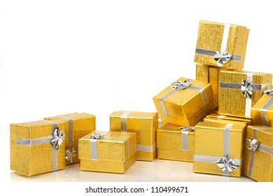 Gold presents on white background