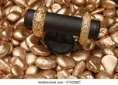 Gold product on golden stone