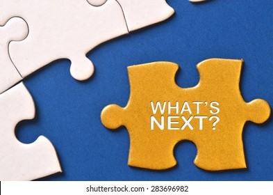 Gold puzzle written with 'what's next'