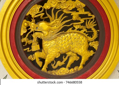 gold Qilin wall sculpture in Chinese temple