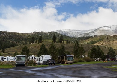 Gold Ranch RV resort, Verdi, Nevada - April 25 : Snow on the mountains behind a busy RV park, early spring, April 25 2015 Gold Ranch RV resort, Vardi, Nevada.