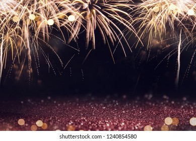 Gold and red Fireworks and bokeh in New Year eve and copy space. Abstract background winter holiday.