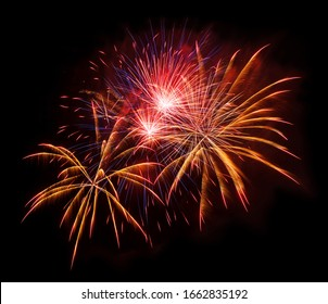 Gold and red fireworks isolated on a black background, element for design