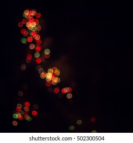 Gold, red and green blurred firework in the night