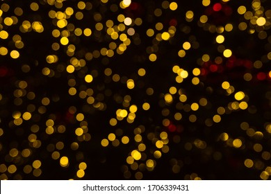 Gold and red lights in defocus. Beautiful bokeh for Christmas
