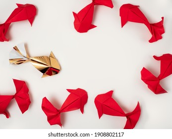 Gold and red paper origami koi carp fishes on a cream background. Eight lucky fish.  Simple top down flat lay