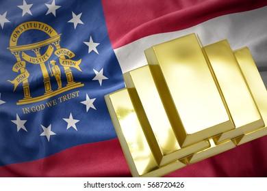 gold reserves. shining golden bullions on the georgia state flag background