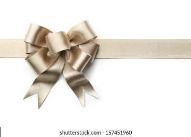 Gold ribbon with bow isolated on white