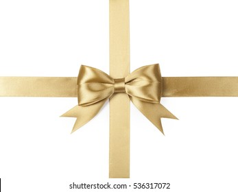 Gold ribbon with bow isolated on white.