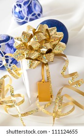 Gold ribbon gift with festive holiday background
