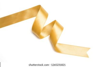 Gold ribbon in roll on white background
