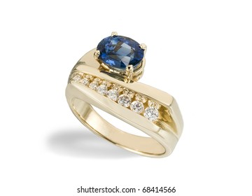 gold ring with big blue topaz stone and eight smaller diamonds