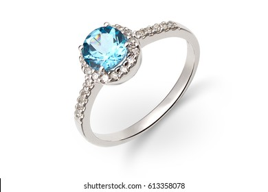 Gold ring with blue and white gem