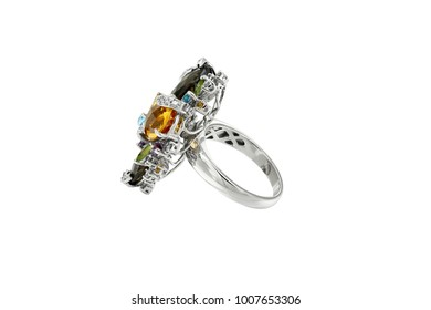 Gold ring with diamonds and colorful gems isolated on white background
