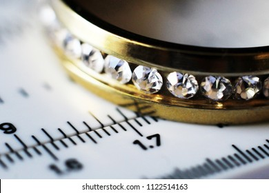 Gold ring with diamonds and a measuring instrument, the value of jewelry, object