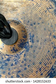Gold ring pattern overlapping the old cymbals.