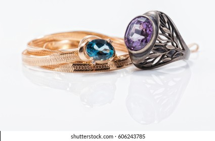 Gold rings encrusted with Topaz and onyx