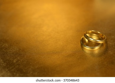 Gold rings on gold background