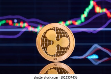 Gold ripple on a bright background of business graphics close-up. Ripple crypto-currency. Anonymous. Virtual currency.
