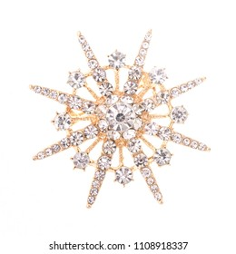 gold round brooch with diamonds isolated on white