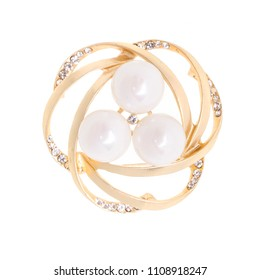 gold round brooch with pearls and gems isolated on white