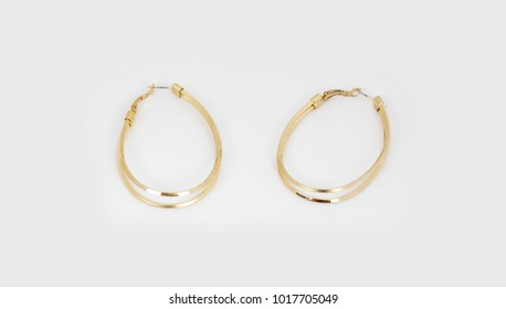 gold round hoops earrings on white background
